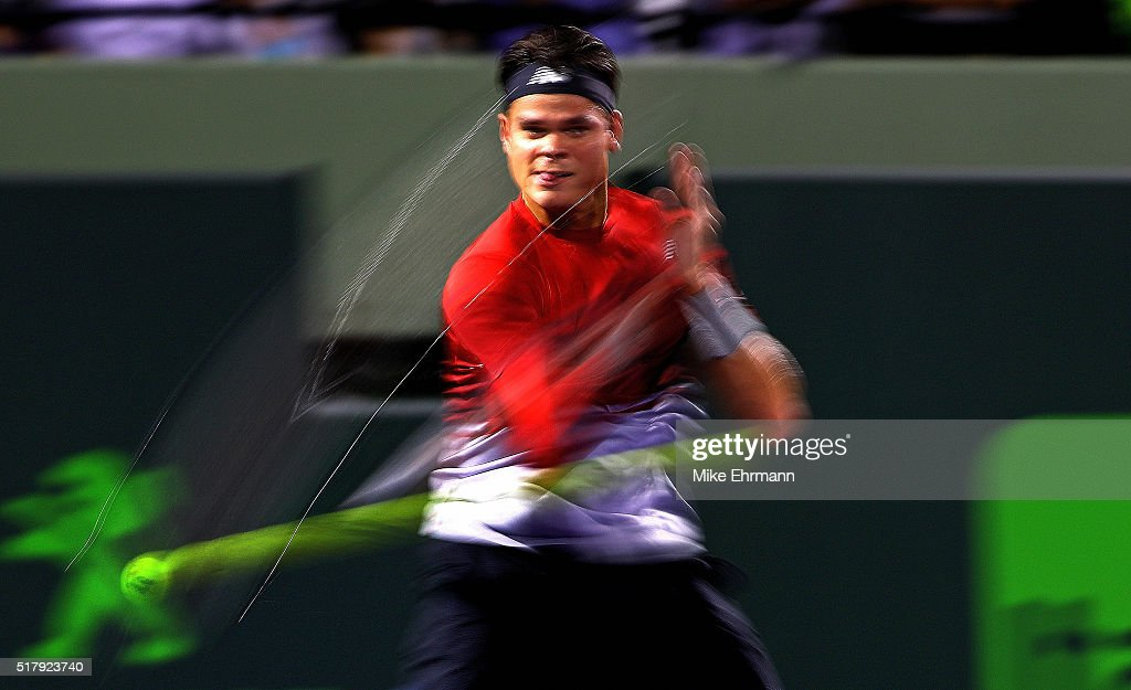 Milos Raonic of Canada plays a match against Jack Sock during Day 8 of the Miami Open presented by Itau at Crandon Park Tennis Center on March 28, 2016 in Key Biscayne, Florida.