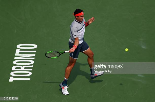 Milos Raonic of Canada plays a shot against against Frances Tiafoe of the United States during a 2nd round match on Day 3 of the Rogers Cup at Aviva...