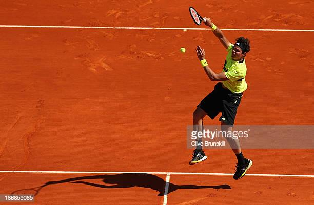 Milos Raonic of Canada plays a smash against Julien Benneteau of France in their first round match during day two of the ATP Monte Carlo Mastersat...