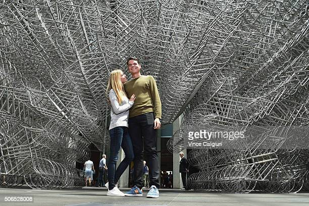 Milos Raonic of Canada poses with girlfriend Danielle Knudson in front of Ai Weiwei Forever Bicycles exhibition at The National Gallery Victoria...