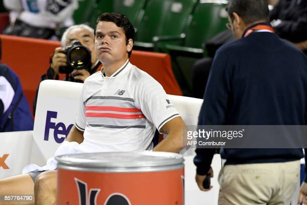Milos Raonic of Canada reacts during his men's singles second round match against Yuichi Sugita of Japan at the Japan Open tennis tournament in Tokyo...
