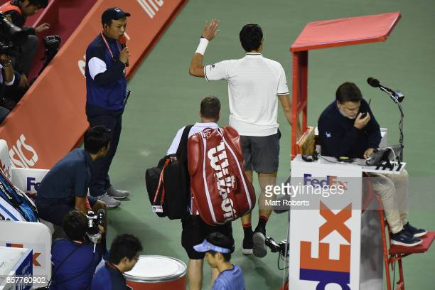 Milos Raonic of Canada retires injured from his match against Yuichi Sugita of Japan during day four of the Rakuten Open at Ariake Coliseum on...