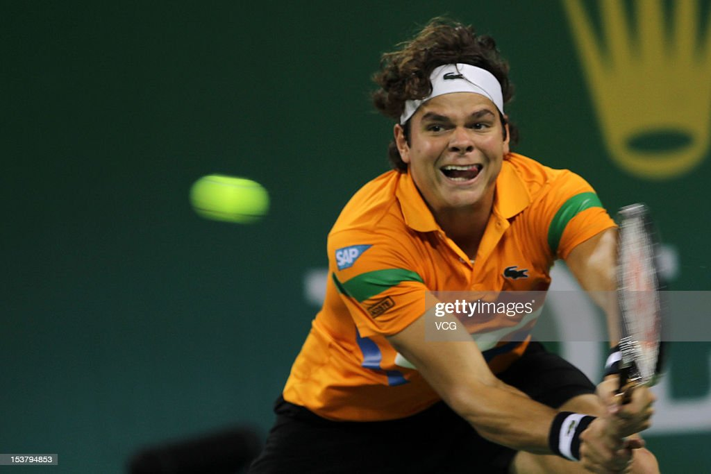 Milos Raonic of Canada returns a ball to Marinko Matosevic of Australia during day three of the Shanghai Rolex Masters at the Qi Zhong Tennis Center on October 9, 2012 in Shanghai, China.