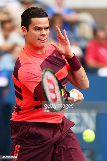 Milos Raonic of Canada returns a shot against Feliciano Lopez of Spain during their Men's Singles Third Round match on Day Five of the 2015 US Open...