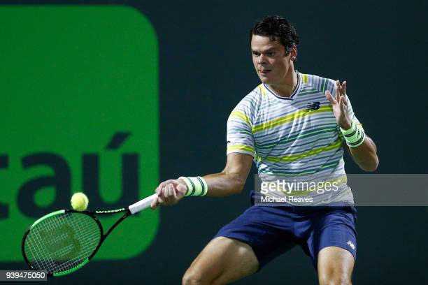 Milos Raonic of Canada returns a shot against Juan Martin Del Potro of Argentina during their quarterfinal match on Day 10 of the Miami Open...