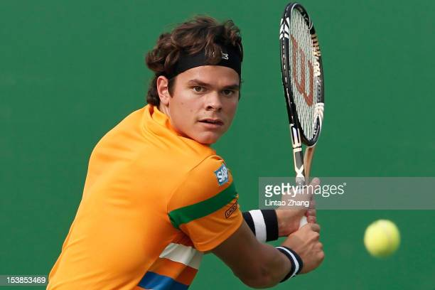 Milos Raonic of Canada returns a shot to Marcos Baghdatis of Cyprus during the day four of Shanghai Rolex Masters at the Qi Zhong Tennis Center on...