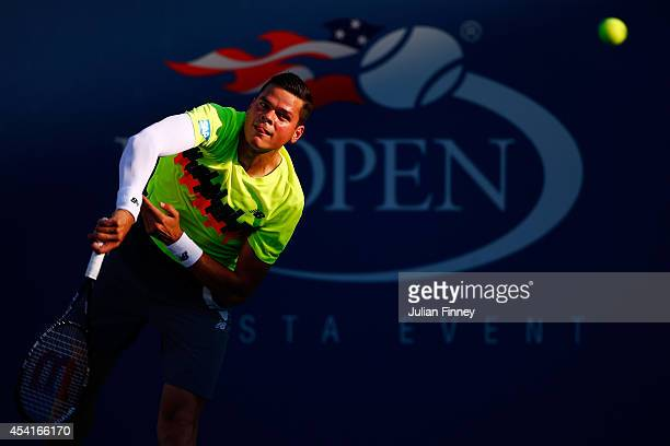 Milos Raonic of Canada returns a shot to Taro Daniel of Japan during his men's singles first round match on Day One of the 2014 US Open at the USTA...