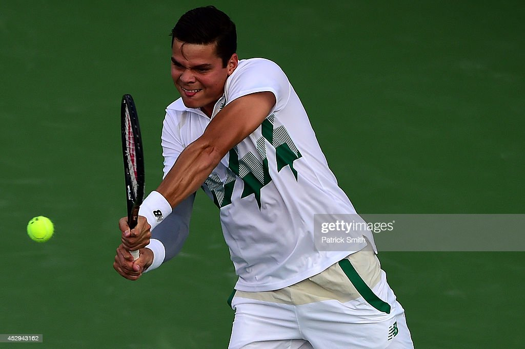 Milos Raonic of Canada returns shot to Jack Sock of the United States during Day 3 of the Citi Open at the William H.G. FitzGerald Tennis Center on July 30, 2014 in Washington, DC.