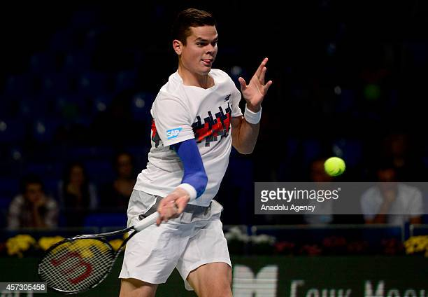 Milos Raonic of Canada returns the ball Ricardas Berankis of Lithuania during the men single tennis match on the sixth day of Kremlin Cup 2014 Tennis...