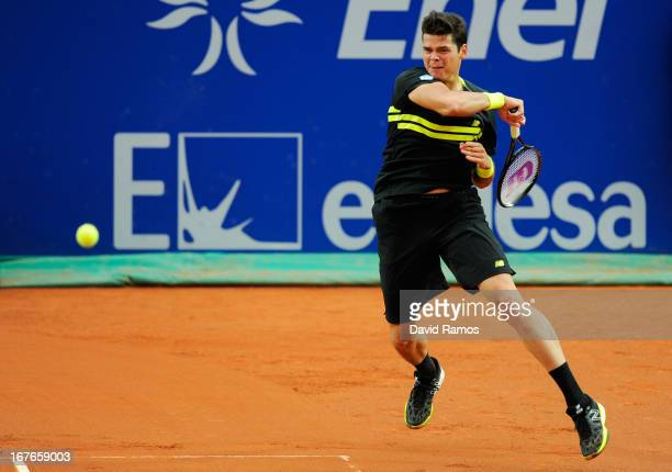 Milos Raonic of Canada returns the ball to Rafael Nadal of Spain during his semifinal match of day six of the 2013 Barcelona Open Banc Sabadell on...