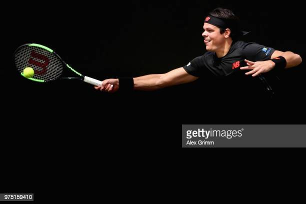 Milos Raonic of Canada returns the ball to Tomas Berdych of Czech Republic during day 5 of the Mercedes Cup at Tennisclub Weissenhof on June 15 2018...
