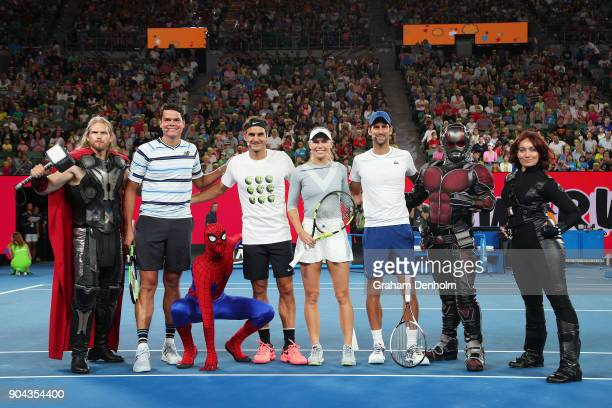 Milos Raonic of Canada Roger Federer of Switzerland Caroline Wozniacki of Denmark and Novak Djokovic of Serbia pose with Marvel characters following...