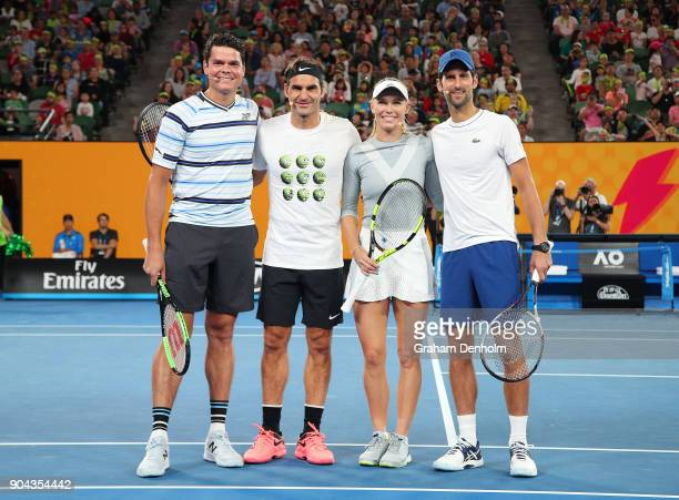 Milos Raonic of Canada Roger Federer of Switzerland Caroline Wozniacki of Denmark and Novak Djokovic of Serbia pose following the Rod Laver Arena...