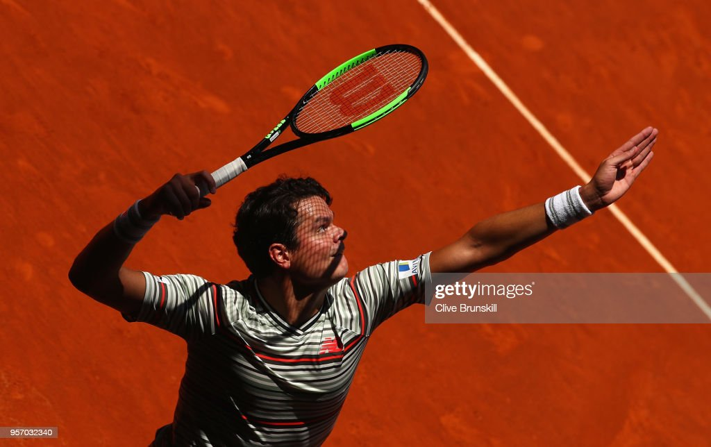 Milos Raonic of Canada serves against Denis Shapovalov of Canada in their third round match during day six of the Mutua Madrid Open tennis tournament at the Caja Magica on May 10, 2018 in Madrid, Spain.