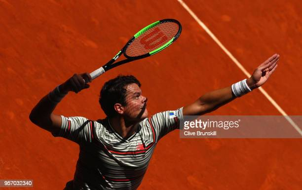 Milos Raonic of Canada serves against Denis Shapovalov of Canada in their third round match during day six of the Mutua Madrid Open tennis tournament...