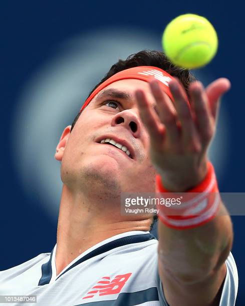 Milos Raonic of Canada serves against Frances Tiafoe of the United States during a 2nd round match on Day 3 of the Rogers Cup at Aviva Centre on...