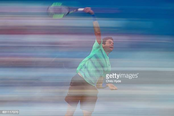Milos Raonic of Canada serves against Grigor Dimitrov of Bulgaria during their semi final match during day seven of the 2017 Brisbane International...