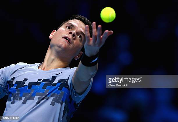 Milos Raonic of Canada serves against Roger Federer of Switzerland during their round robin match during the Barclays ATP World Tour Finals at the O2...