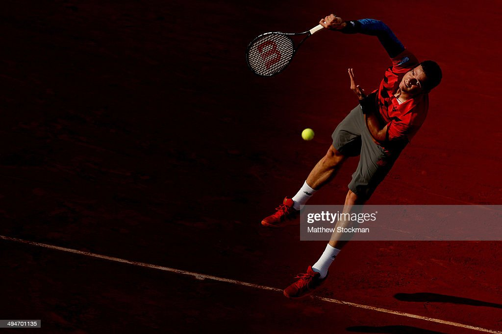Milos Raonic of Canada serves during his men's singles match against Gilles Simon of France on day six of the French Open at Roland Garros on May 30, 2014 in Paris, France.