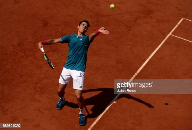 Milos Raonic of Canada serves during the first round match against Steve Darcis of Belgium on day two of the 2017 French Open at Roland Garros on May...