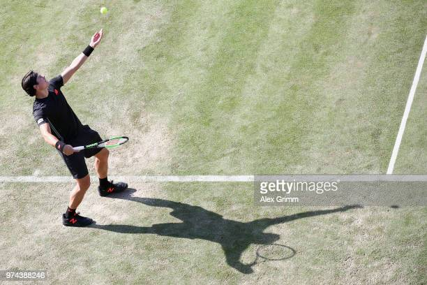 Milos Raonic of Canada serves the ball to Marton Fucsovics of Hungary during day 4 of the Mercedes Cup at Tennisclub Weissenhof on June 14 2018 in...