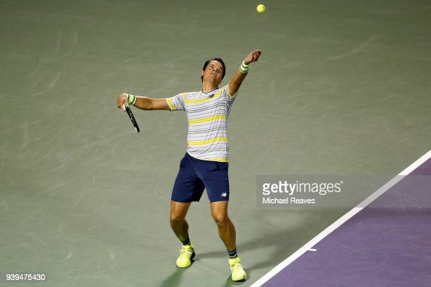 Milos Raonic of Canada serves to Juan Martin Del Potro of Argentina during their quarterfinal match on Day 10 of the Miami Open Presented by Itau at...