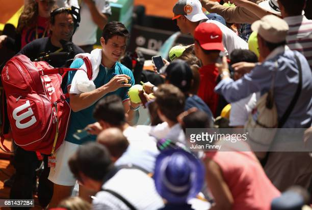 Milos Raonic of Canada signs autographs after his win against Gilles Muller of Luxembourg during day five of the Mutua Madrid Open tennis at La Caja...
