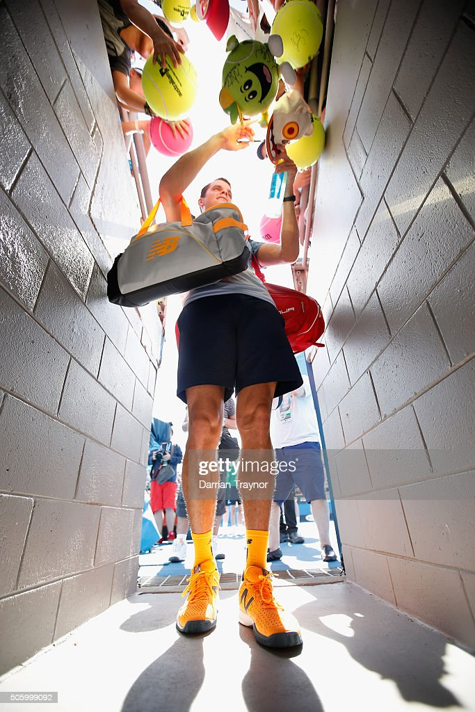 Milos Raonic of Canada signs autographs after winning his second round match against Tommy Robrado of Spain during day four of the 2016 Australian Open at Melbourne Park on January 21, 2016 in Melbourne, Australia.