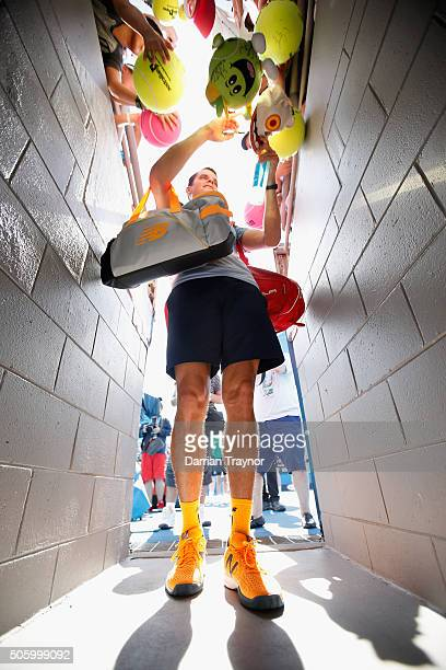 Milos Raonic of Canada signs autographs after winning his second round match against Tommy Robrado of Spain during day four of the 2016 Australian...