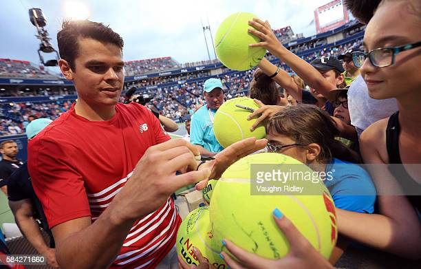 Milos Raonic of Canada signs autographs for fans after his victory over Jared Donaldson of the USA during Day 4 of the Rogers Cup at the Aviva Centre...