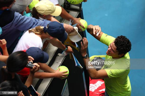 Milos Raonic of Canada signs autographs for fans after winning his Men's Singles fourth round match against on day seven of the 2020 Australian Open...