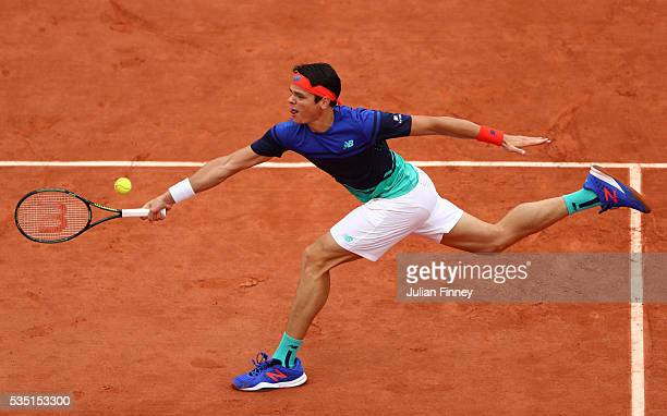 Milos Raonic of Canada stretches to hit a forehand during the Men's Singles fourth round match against Alberto Ramos Vinolas of Spain on day eight of...