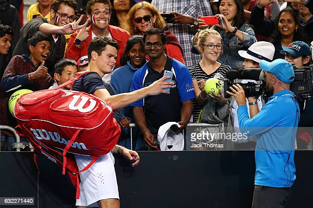 Milos Raonic of Canada takes a selfie with fans after his third round match against Gilles Simon of France on day six of the 2017 Australian Open at...