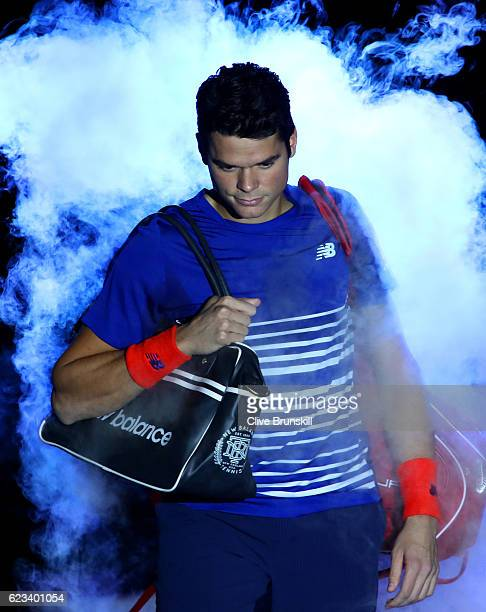Milos Raonic of Canada walks out for his men's ingles match against Novak Djokovic of Serbia on day three of the ATP World Tour Finals at O2 Arena on...