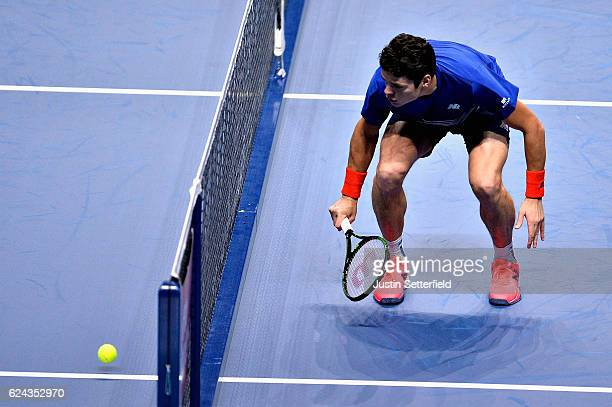 Milos Raonic of Canada watches his ball drop just over the net during his men's singles semi final against Andy Murray of Great Britain on day seven...