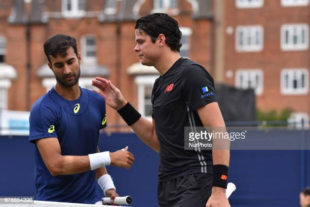 Milos Raonic of Canada wins against Yuki Bhambri in the first singles match on day two of Fever Tree Championships at Queen's Club, London on June...