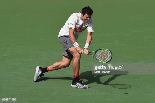 Milos Raonic plays a backhand against Viktor Troicki of Serbia during day two of the Rakuten Open at Ariake Coliseum on October 3 2017 in Tokyo Japan
