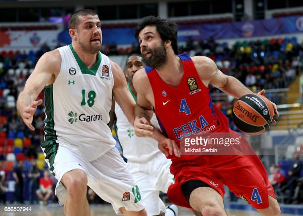 Milos Teodosic #4 of CSKA Moscow competes with Adrien Moerman #18 of Darussafaka Dogus Istanbul in action during the 2016/2017 Turkish Airlines...