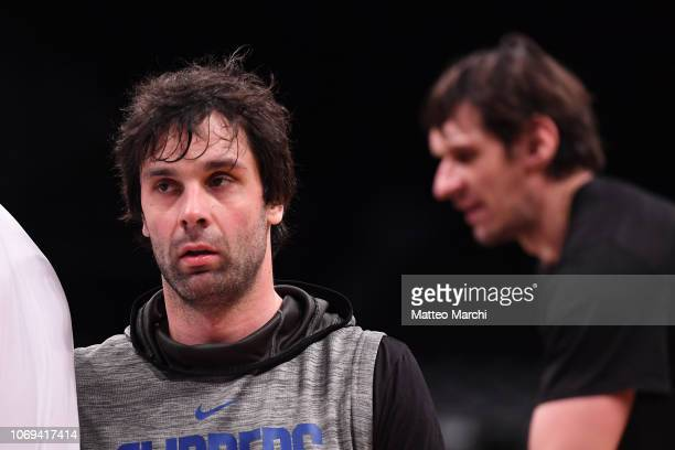 Milos Teodosic and Boban Marjanovic of the Los Angeles Clippers warm up before the game against the Brooklyn Nets at Barclays Center on November 17,...