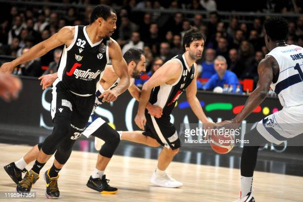 Milos Teodosic and Vincent Hunter of Virtus Segafredo competes with Rok Stipcevic and Henry Sims of Fortitudo Pompea during the LegaBasket italian...