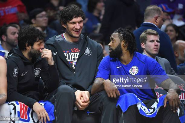 Milos Teodosic Boban Marjanovic and DeAndre Jordan of the Los Angeles Clippers talk on the bench in the second half of the game against the New York...