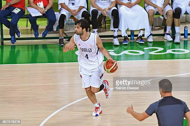 Milos Teodosic of Serbia dribbles the ball against the USA Basketball Men's National Team during the Gold Medal Game on Day 16 of the Rio 2016...