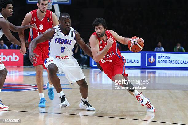 Milos Teodosic of Serbia drives to the basket against Charles Kahudi of France during the EuroBasket 3rd place game between France v Serbia at Stade...