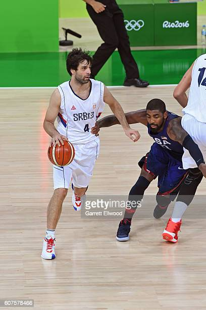 Milos Teodosic of Serbia drives to the basket against Kyrie Irving of the USA Basketball Men's National Team during the Gold Medal Game on Day 16 of...