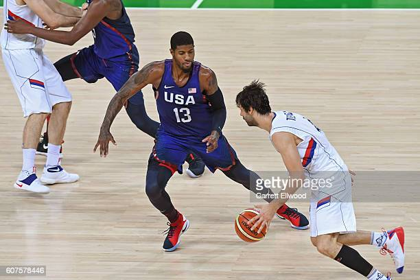 Milos Teodosic of Serbia drives to the basket against Paul George of the USA Basketball Men's National Team during the Gold Medal Game on Day 16 of...