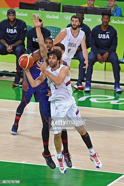 Milos Teodosic of Serbia handles the ball against the USA Basketball Men's National Team during the Gold Medal Game on Day 16 of the Rio 2016 Olympic...