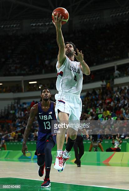 Milos Teodosic of Serbia shoots the ball over Paul George of United States during the Men's Gold medal game on Day 16 of the Rio 2016 Olympic Games...