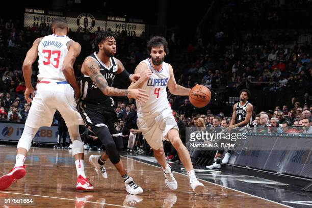 Milos Teodosic of the LA Clippers handles the ball against D'Angelo Russell of the Brooklyn Nets on February 12 2018 at Barclays Center in Brooklyn...
