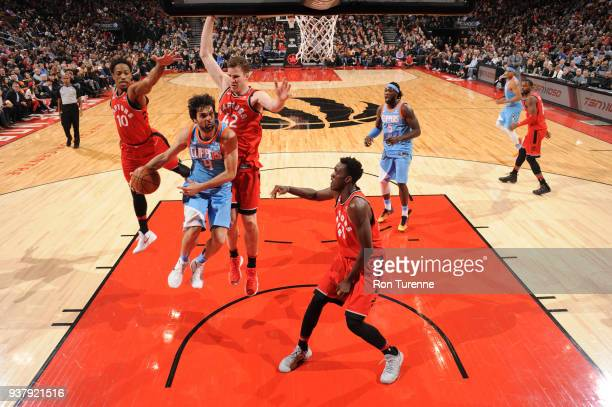 Milos Teodosic of the LA Clippers handles the ball against the Toronto Raptors on March 25 2018 at the Air Canada Centre in Toronto Ontario Canada...