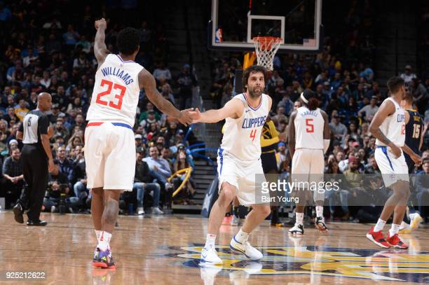 Milos Teodosic of the LA Clippers high fives Lou Williams of the LA Clippers on February 27 2018 at the Pepsi Center in Denver Colorado NOTE TO USER...